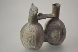 A Peruvian pottery double chamber and whistle stirrup vessel, possibly Chimu, Pre-Columbian, c.