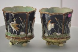 A pair of majolica jardinieres, each cylindrical, with flared rim and green/turquoise glazed