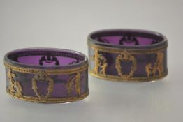 A striking pair of Continental large amethyst glass salts, 19th century, in the Empire taste,