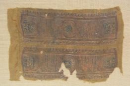 A fragment of Coptic textile, Egyptian, c. 6th century AD worked in polychrome threads with twin