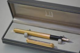 An Alfred Dunhill Gemline dress fountain pen, vermeil grain d'orge, 1980's, with faux