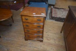 A 19thc style walnut chest of drawers, the plain top with moulded edge, four long drawers raised