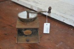A cast iron table top coffee grinder