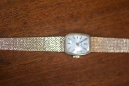 A lady's Tissot 9ct gold wristwatch and strap, total weight 22.1g