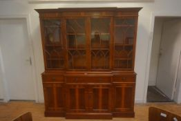 A yew wood breakfront bookcase cabinet, in 18th century style, the moulded top above four astragal