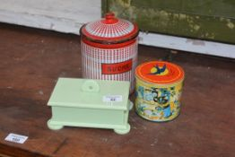 A mixed lot comprising an enamel sugar, jar and lid, bluebird toffee tin and an Art Deco green