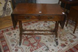 A 19thc style mahogany sofa table, the rectangular top above two frieze drawers on trestle base,