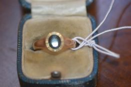 A gentleman's signet ring set with a single green stone on 9ct gold band, 4.7g