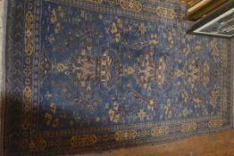 An Iranian rug, the central panel with triple floral vase design enclosed within a triple flowerhead