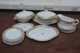 A dolls miniature part dinner set, comprising ashets, tureens, dinner plates and side plates