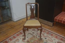 A George II walnut side chair c. 1740 with drop in seat and raised on pad feet.