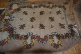 A wool rug decorated with roses on cream and brown field, 188cm x 240cm, a/f