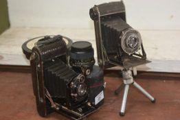 Two folding bellows cameras, together with a Minolta lens and a developer pot (a lot)