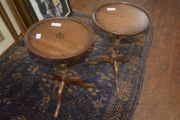 A pair of mahogany wine tables on turned supports and tripod bases
