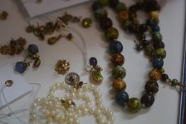 A mixed lot of jewellery including pearls, beads, earrings and a yellow metal tear drop shaped