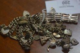 Two silver charm bracelets, a silver gate link bracelet and two curb link bracelets, 136.7g (a lot)