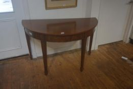 A pair of 19thc mahogany d-end tables, the plain tops with plain frieze, on square tapered supports,