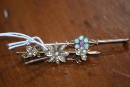 Two bar brooches, one set with seed pearls, the other with opals and garnet, marked 9ct