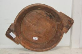 A Continental circular twin handled wooden bowl
