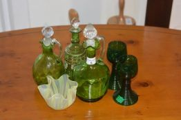 A mixed lot of coloured glass including oil bottles, glasses and a ribbon plate etc (a lot)