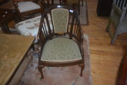 An Edwardian inlaid rosewood horseshoe shaped arm chair, upholstered back panel and slats,