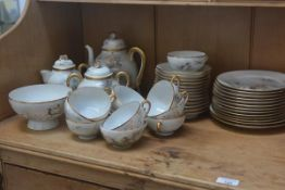 A Japanese export egg shell teaset of eleven cups, saucers sugar, cream etc, some damage