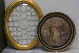 An oval gilt frame containing a collection of 18th century style plaster intaglios, together with