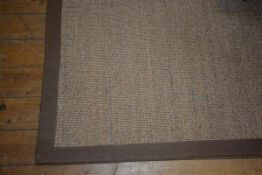 A Crucial Trading sisal rug with woven linen border, 275cm x 201cm