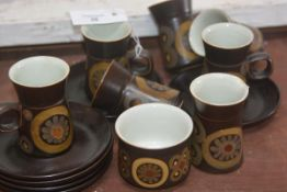 A Denby vintage coffee set of six cups, saucers, sugar and cream