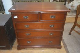 A 19thc style mahogany chest of drawers, the rectangular top with moulded edge, two short over three