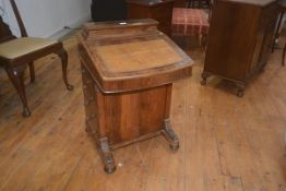 A late 19thc walnut davenport, the top with hinged stationery box, writing slope with inset