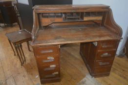 An early 20thc oak roll top desk, on two banks of drawers, 112cm x 122cm x 75cm