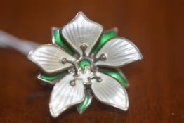 An enamel and white metal lily pad brooch by David Anderson of Norway, marks to rear (sterling)