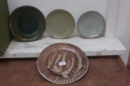 Carolina M. Valvona, a group of four studio pottery plates (4)