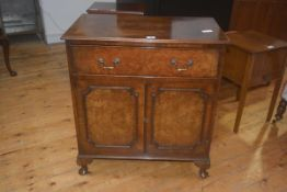 A 19thc style walnut cupboard, the crossbanded rectangular top with moulded edge above single frieze
