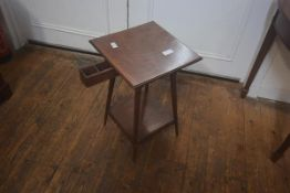 An early 20thc mahogany lamp table, the square top with moulded edge, fitted with a drawer, square