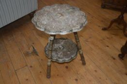 A 19thc Indian painted occasional table, the circular top with scalloped edge, all over painted