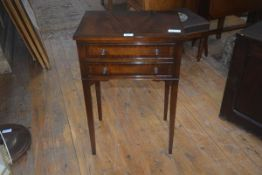 A 19thc style mahogany side table, the crossbanded top above two long drawers, raised on square