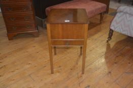 A vintage walnut work table, the hinged top enclosing lined interior, single frieze drawer on square