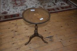 A 19thc style wine table, the circular top on tripod base