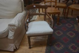 A 19thc mahogany armchair with stuffed over seat