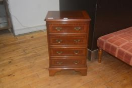 A 19thc style mahogany chest of drawers, the crossbanded top with moulded edge and canted corners,