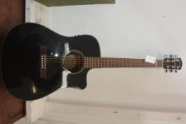 A Fender acoustic six string guitar
