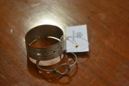 A hallmarked silver engraved bangle and a white metal bangle (2)