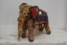 An Indian made cloth elephant with all over needlework decoration