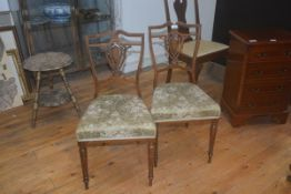 A pair of Edwardian inlaid rosewood bedroom chairs with upholstered seats