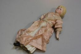 A 19thc bisque head doll with stuffed body, bisque hands, arms and feet (h.30cm), £30-40