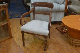 A Regency mahogany carver chair with curved top rail and scroll arms, with stuffover seat, on turned