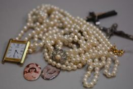 Two enamelled portrait panels, two crucifixes, a paste pearl necklace with cultured pearl, white met