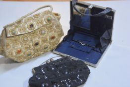 A 1950s beaded evening bag, a silk gold and silver thread evening bag and a 1930s chrome mounted lad